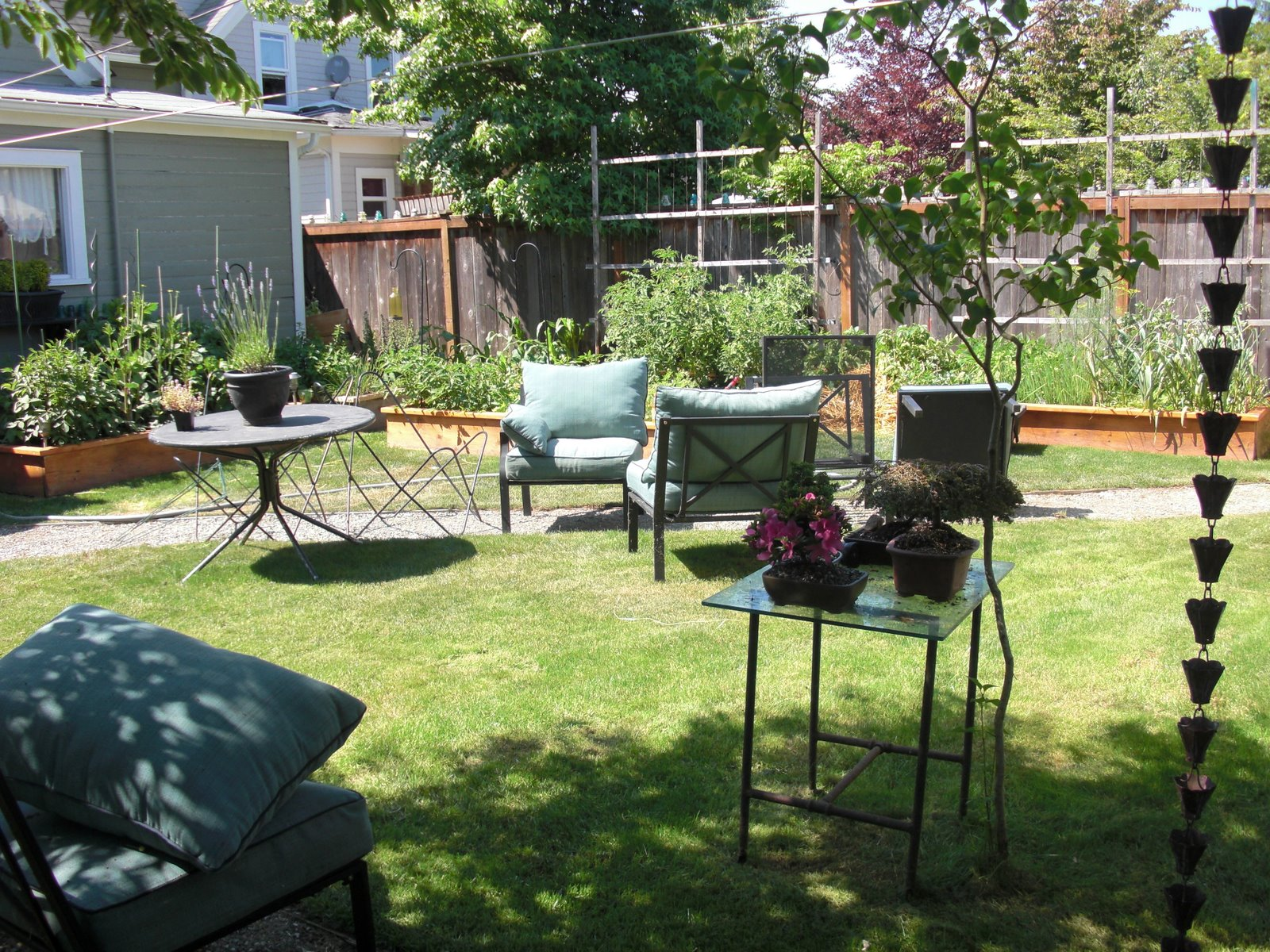 We Have A Patch Of Grass In The Middle Of Our Back Yard That Acts As A Patio  With Our Outdoor Sectional, Bar B Que, Fire Pit And Table.