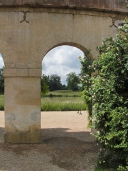 View of pond through arch